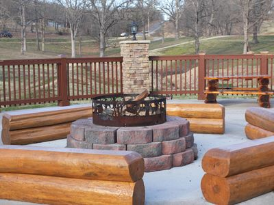 Community firepit and benches just outside pool.