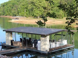 La Follette house photo - The private dock has a hydraulic lift, w/plenty of space for boats and jet skis.
