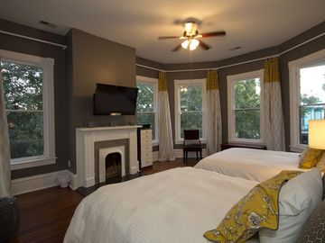 Our grey room has two queen size beds and an HD tv.