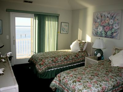 two twin beds, balcony overlooking bay