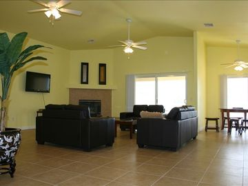 Desert Hot Springs house rental - view of living room. All furniture is brand new. High ceilings, crown molding