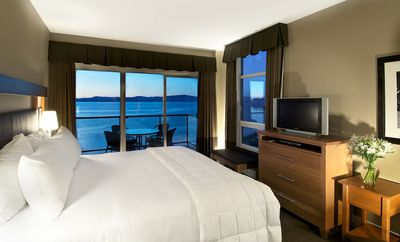 This bedroom boasts a deluxe king bed and spectacular ocean views.