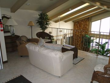 Loft sitting area over-looking indoor heated saltwater pool & looking out at Bay