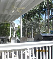 Key West house photo - Back deck with chairs, table and a grill.