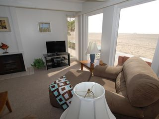 Balboa Peninsula house photo - Large windows reveal the surf and sand from the living room.