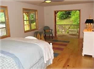 Master Bedroom French Doors open to Screened Porch Overlooking Creek.