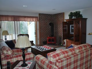 North Conway condo photo - Cozy living room with wood stove,big sized checkers anyone??