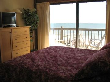 Master bedroom with sliding glass door to oceanfront deck