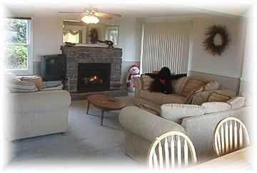 great room with gas fireplace and three sofas, expansive ocean view behind you