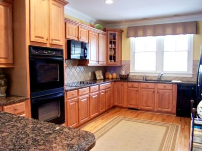 Gourmet Kitchen with granite countertops and start of the art appliances