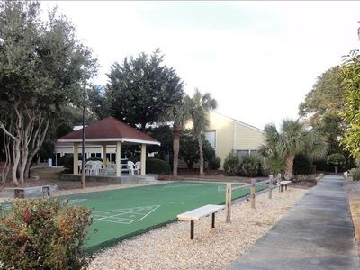 Rec center (background) and covered pavillion for shuffleboard and tennis courts