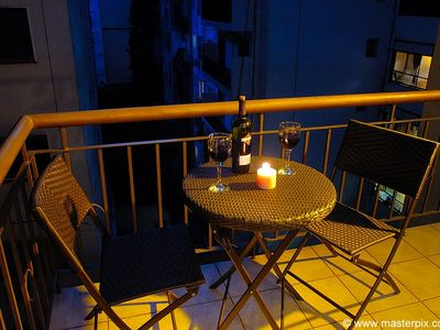 Have a romantic glass of wine on the outside private balcony w/ table & 2 chairs
