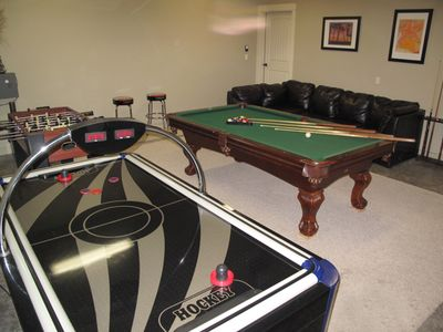 Playroom with Pool Table, Air Hockey, Foosball and sand toys for kids.