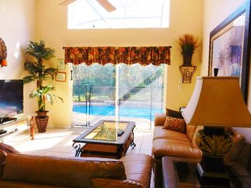 Emerald Island villa rental - Family room opens to the pool (here pool safety fence in place)