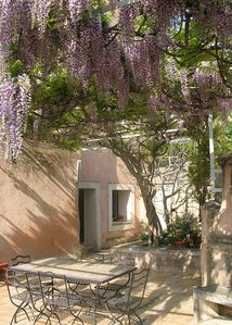 Book in April to enjoy the wisteria on the terrace in full bloom