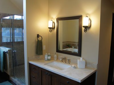Master bath (3rd floor) with individual vanities and large walk-in shower.