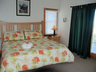 Corolla house photo - King bed in Family Suite with pool, golf, Sound and ocean views!
