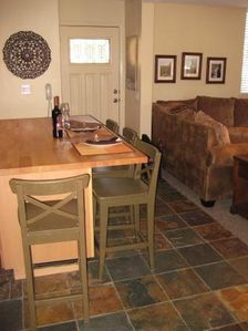 Kitchen has beautiful slate floors and is open to living area