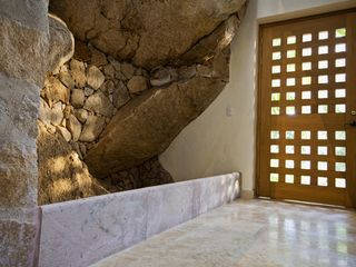 Puerto Vallarta villa photo - The front door entrance way with marble floors and that rock!
