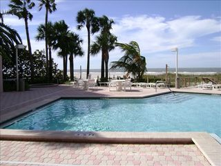 Sand Key condo photo - Heated outdoor pool and hot tub