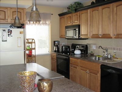 Recently renovated kitchen of one bedroom, Gulf-front condo.