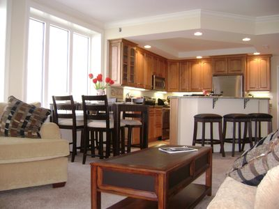 Belmont Towers Ocean City condo rental - Living room to kitchen view