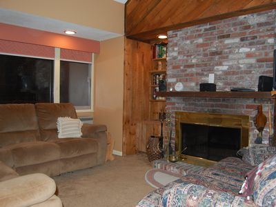 Campton condo rental - Cozy living room with wood burning fireplace
