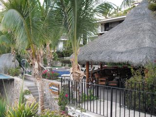 Cabo San Lucas condo photo - The large palapa next to the pool is great for a nap or reading in the shade.