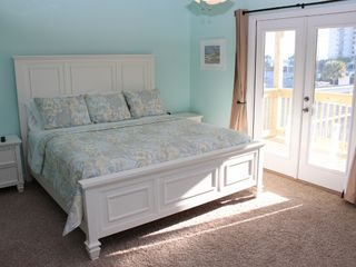 Thomas Drive Area house photo - MASTER BEDROOM WITH KING SIZE BED, 32' TV AND POARCH THAT OVERLOOKS THE POOL