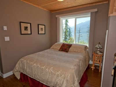 From the bedroom window, enjoy views of the forest and lake.