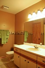 Branson condo photo - Master bathroom with his and hers sinks with jetted tub/shower.