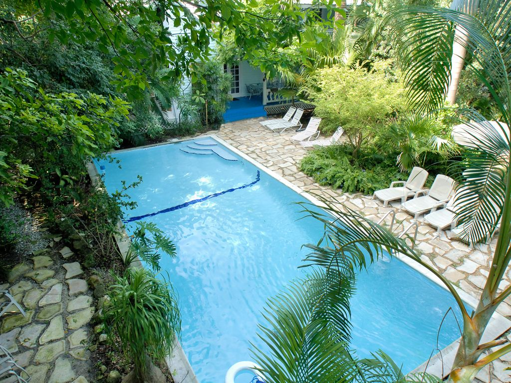 Large swimming pool in gated pool garden compound for Garden 7 pool