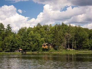 Piseco Lake cabin photo - From Across the Lake - Total Privacy - boat house is on left