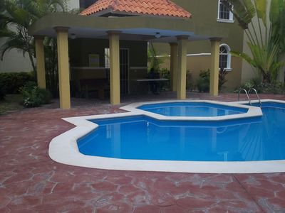 Pool area with gazebo and grill