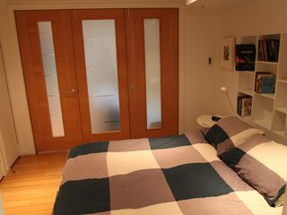 Brooklyn apartment photo - Bedroom with folding doors closed