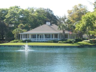 St. Simons Island condo photo - View across the stocked fishing pond to the clubhouse.