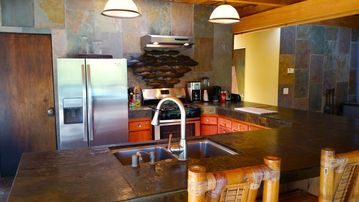 Carmel Valley chalet rental - Kitchen has stainless everything, gas stove, bar seating and ideal entertaining!