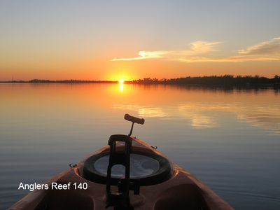 Pausing to enjoy a sunset after a kayak ride in front of Anglers Reef