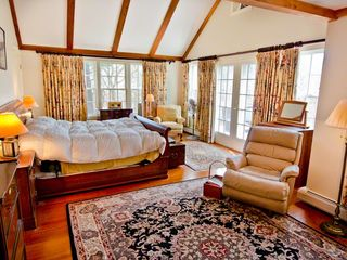 Chilmark house photo - Bedroom #1 - Master Suite Features Vaulted Ceiling, Fireplace, King Bed, Walk-in Closet & Full Bath