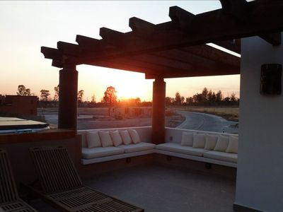 sunset form uuper floor with hot tub, bathroom, BQ and more. Peace and quiet.