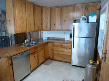 New kitchen, knotty oak cabinets to match knotty pine. Stainless appliances