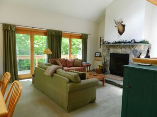 Carrabassett Valley condo photo - Living room with plush couches facing the gorgeous fireplace.