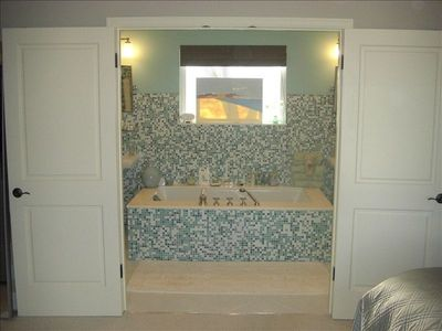 2 person soaking tub in Master.  Double doors allow you to soak to the view.