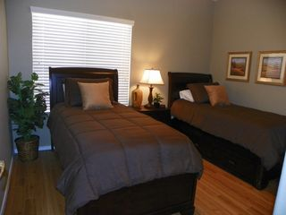 San Tan Valley house photo - Bedroom 4 with two twin-size beds and plush bedding and storage under each bed