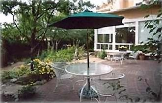 Meet for Tea Under the Patio Umbrella