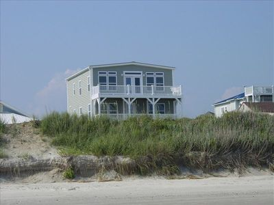House is beyond dune & sand covered 1 way street