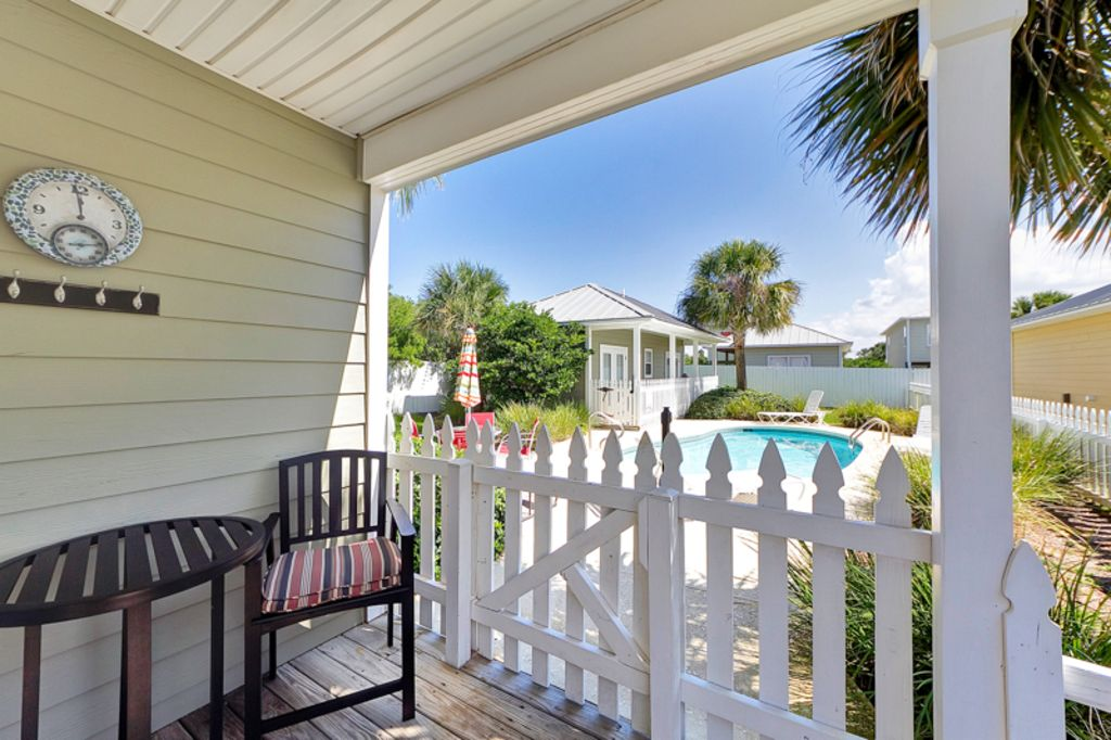 Covered porch off back of main house, natural gas grill, bistro table, pool!