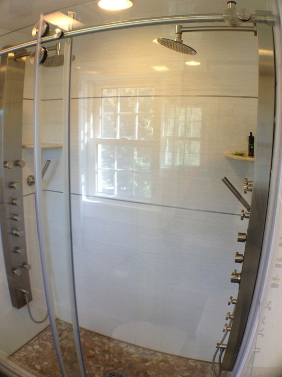 The Master custom tile/pebble shower with dual Spa shower panels w/ body sprays.