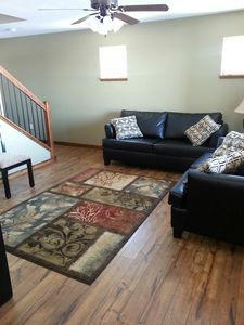 Okoboji cabin rental - Living area with full and twin sofa beds, and flat screen tv