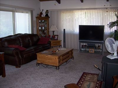 over size living room with flat screen TV/DVD